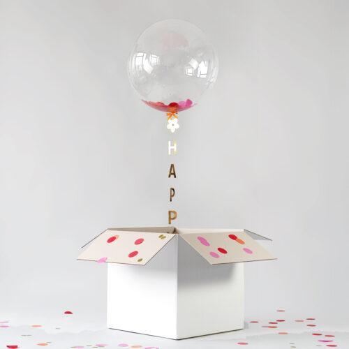 Mit Helium und Konfetti gefüllter Geschenkballon zum Geburtstag
